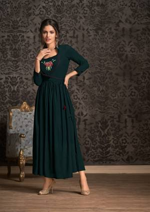 Grab This Very Pretty And Elegant Looking Designer Readymade Long Kurti In Pine Green Color Fabricated On Rayon. Its Pretty Pattern And Fabric Ensures Superb Comfort all Day Long. Buy This Kurti Now.