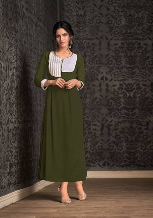Add This Pretty Readymade Long Kurti To Your Wardrobe In Olive Green For Your Semi-Casuals. This Kurti IS Fabricated On Rayon Beautified With Pattern Over Neck And Sleeves.