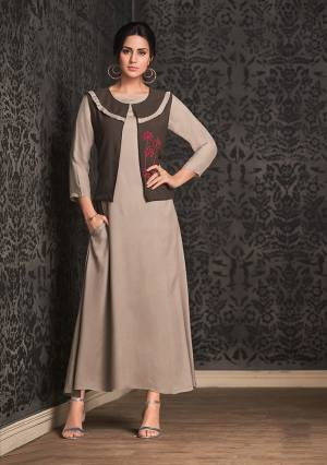 New Shade Is Here With This Designer Readymade Koti Patterned Kurti In Sand Grey And Brown Color Fabricated On Rayon. This Kurti Is Beautified With Thread Work And Also Light In Weight To Carry All Day Long.