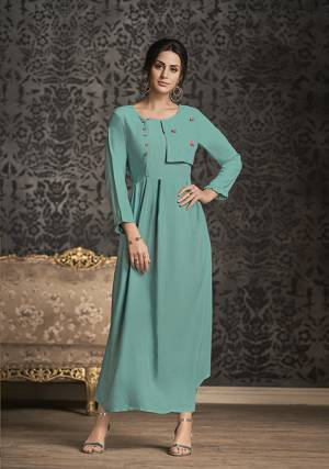 Simple And Elegant Looking Readymade Long Kurti Is Here For Your Semi-Casual Wear Is Here In Lovely Turquoise Blue Color. This Kurti IS Fabricated On Rayon Which Is Soft Towards Skin And Available In All Sizes.