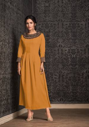 Celebrate This Festive Season With Beauty And Comfort Wearing This Designer Readymade Kurti In Musturd Yellow Color Fabricated On Rayon. It Is Beautified With Fancy Lace Border And Light In Weight And Easy To Carry All Day Long.