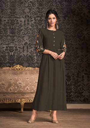 Enhance Your Personality Wearing This Designer Readymade Lonf Kurti In Dark Brown Color Fabricated On Rayon. This Kurti Is Beautified With Thread Work Over The Sleevs Giving It An Attractive Look. Buy Now.