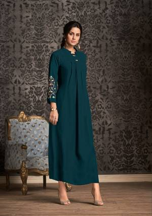 Lovely Shade Is Here With This Designer Readymade Long Kurti In Prussian Blue Color Fabricated On Rayon. It Is Beautified with Thread Work Over The Sleeves With Multi Color.  It Is Light Weight And Easy To Carry All Day Long.