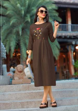 Enhace Your Personality Wearing This Designer Readymade Kurti In Brown Color Fabricated Cotton Which IS Light Weight, Durable And Easy To Carry All Day Long.  Buy Now.
