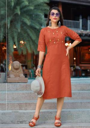 Simple and Elegant Looking Designer Straight Kurti IS Here In Rust Orange Color Fabricated On Cotton. This Pretty Readymade Kurti Is Available In All Regular Sizes, Choose As Per Your Desired Fit And Comfort.