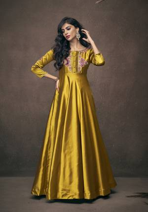 Here Is A Very Pretty Designer Readymade Gown In Yellow Color Fabricated On Satin Silk. This Pretty Gown Is Beautified With Attractive Embroidery Over The Yoke And Sleeves. Also It Is Light In Weight And Easy To Carry Throughout The Gala.