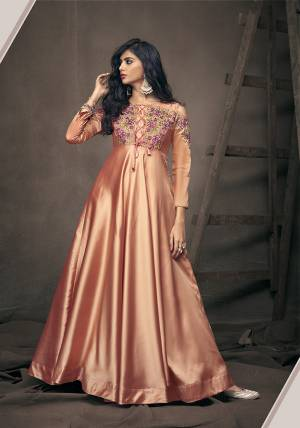 A Must Have Shade In Every Womens Wardrobe Is Here With This Designer Readymade Gown In Peach Color. It Is Beautified With Lovely Patterns And Embroidery Over The Yoke And Sleeves. Buy This Pretty Gown Now.