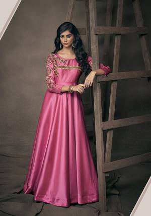 Get Ready For The Upcoming Festive And Wedding Season With This Designer Readymade Gown In Rani Pink Fabricated On Satin Silk. This Pretty Gown Has Attractive Embroidery Over The Yoke And Sleeves. Buy Now.