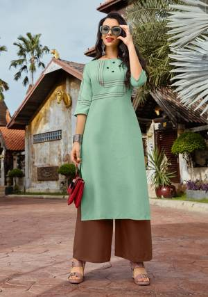 Rich And Elegant Looking Designer Readymade Kurti And Plazzo Set Is Here With Simple Thread Work And Buttons. This Pretty Sea Green Colored Kurti Is Paired With Contrasting Brown Colored Bottom. Its Top Is Cotton Based Paired With Rayon Fabricated Bottom.