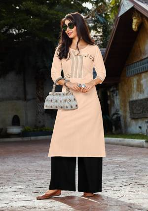 Simple And Elegant Looking Readymade Set IS Here In Light Peach Colored Kurti Paired With Black Colored Plazzo. Its Top Is Cotton Fabricated Paired With Rayon Fabricated Bottom. It Is Light In Weight And Available In All Regular Sizes, Choose As Per Your Desired Fit And Comfort.