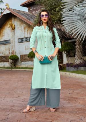Pretty Unique Color Pallete Is Here With This Designer Readymade Set Of Kurti And Plazzo In Aqua Blue And Grey Color Respectively. Its Top Is Cotton Based Paired With Rayon Fabricated Bottom. Both The Fabrics Are Light Weight And Durable. Buy Now.