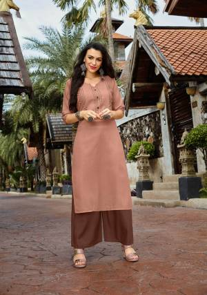 Flaunt Your Rich And Elegant Taste With This Subtle Color Pallet In This Readymade Set Of Kurti And Plazzo. This Cotton based Kurti Is In Beige Color Paired With Rayon Fabricated Bottom. It Is Available In All Regular Sizes, Choose As Per Your Desired Fit And Comfort.