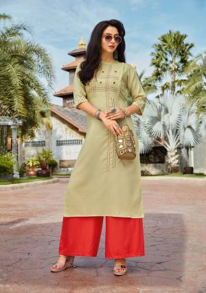 Celebrate This Festive Season With Beauty And Comfort Wearing This Designer Readymade Pair Of Kurti And Plazzo In Pastel Green And Orange Color. Its Top IS Fabricated On Cotton Paired With Rayon Fabricated Bottom. Buy This Now.