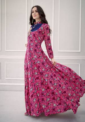 Grab This Very Beautiful Designer Readymade Gown In Dark Pink Color Fabricated On Rayon. This Pretty Gown Is Beautified With Prints All Over And Hand Work. Choose Your Size As Per Your Desired Fit And Comfort.