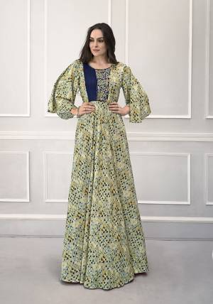 Celebrate This Festive Season With Beauty And Comfort Wearing This Designer Readymade Gown In Light Green Color Fabricated On Rayon. This Pretty Gown Has All Over Prints With Bell Sleeve Pattern. Buy Now.