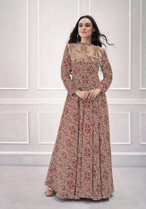 Rich And Elegant Looking Designer Readymade Gown Is Here In Brown Color Fabricated On Rayon. It Is All Beautified With Intricate Prints, And Hand work Over The Yoke.