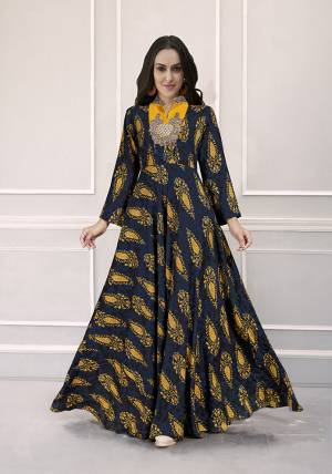 Grab This Very Beautiful Designer Readymade Gown In Navy Blue Color Fabricated On Rayon. This Pretty Gown Is Beautified With Prints All Over And Hand Work. Choose Your Size As Per Your Desired Fit And Comfort.