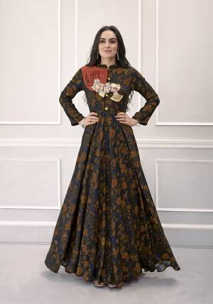 Celebrate This Festive Season With Beauty And Comfort Wearing This Designer Readymade Gown In Royal Blue And Brown Color Fabricated On Rayon. This Pretty Gown Has All Over Prints With Patch Work at The Yoke. Buy Now.