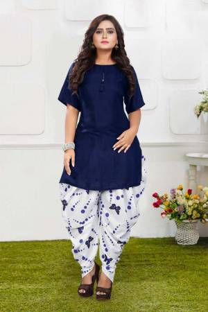 Grab This Pretty Pair Of Readymade Kurti And Dhoti In Navy Blue And White Color. This Kurti Is Fabricated On Rayon Slub Paired With Crepe Fabricated Digital Printed Dhoti. It Is Available In All Regular Sizes And Ensures superb Comfort All Day Long. Buy Now.
