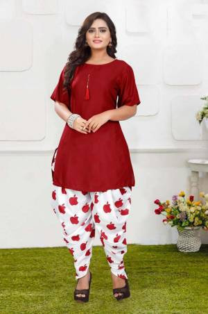 Grab This Pretty Pair Of Readymade Kurti And Dhoti In Red And White Color. This Kurti Is Fabricated On Rayon Slub Paired With Crepe Fabricated Digital Printed Dhoti. It Is Available In All Regular Sizes And Ensures superb Comfort All Day Long. Buy Now.