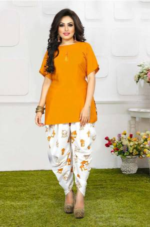 Grab This Pretty Pair Of Readymade Kurti And Dhoti In Musturd YellowAnd White Color. This Kurti Is Fabricated On Rayon Slub Paired With Crepe Fabricated Digital Printed Dhoti. It Is Available In All Regular Sizes And Ensures superb Comfort All Day Long. Buy Now.