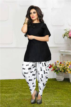 Grab This Pretty Pair Of Readymade Kurti And Dhoti In Black And White Color. This Kurti Is Fabricated On Rayon Slub Paired With Crepe Fabricated Digital Printed Dhoti. It Is Available In All Regular Sizes And Ensures superb Comfort All Day Long. Buy Now.