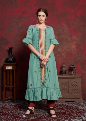 Here Is A Beautiful Jacket Patterned Designer Readymade Kurti In Multi Colored Inner With Light Blue Colored Jacket. Printed Inner Is Fabricated On Rayon Cotton Paired With Muslin Fabricated Embroidered Jacket. It Is Light In Weight And Easy To Carry All Day Long.