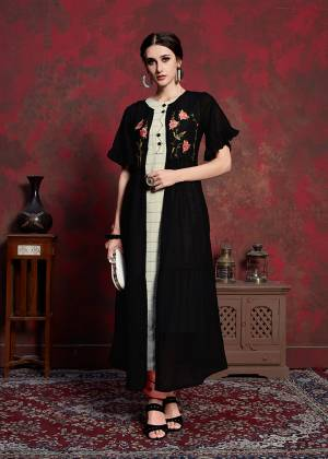 For A Bold And Beautiful Look, Grab This Designer Readymade Kurti With Jacket In Off-White Colored Inner Paired With Black Colored Embroidered Long Jacket. Its Inner Is Rayon Cotton Based Paired With Muslin Jacket. You Can wear It As Ir And Also Pair Up With Pants Or Leggings.
