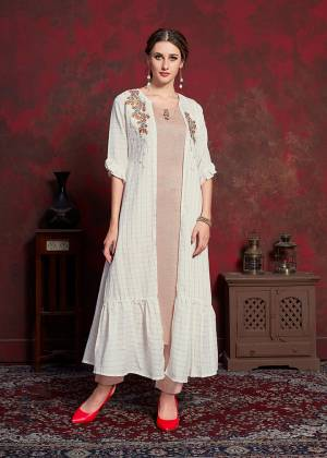 Celebrate This Festive Season With Beauty And Comfort Wearing This Designer Readymade Kurti In Beige Colored Inner Paired With White Colored Jacket. Its Inner Is Fabricated On Rayon cotton Paired With Muslin Fabricated Jacket. Its Rich And Subtle Color Pallete Will Earn You Lots Of Compliments From Onlookers.