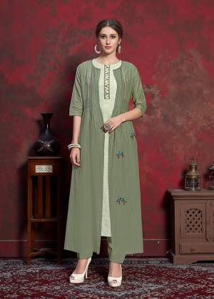 Here Is A Beautiful Jacket Patterned Designer Readymade Kurti In Off-White Colored Inner With Olive Green Colored Jacket. Printed Inner Is Fabricated On Rayon Cotton Paired With Muslin Fabricated Embroidered Jacket. It Is Light In Weight And Easy To Carry All Day Long.