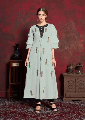 Grab This New And Trending Designer Readymade Kurti In Black And Pale Grey Which Has Pretty Jacket Pattern. Its Inner Is Fabricated On Rayon Cotton Paired With muslin Fabricated Jacket. Its Jacket IS Beautified With Thread Work Giving It An Attractive Look.