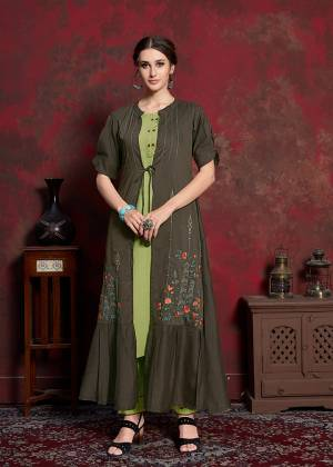 Celebrate This Festive Season With Beauty And Comfort Wearing This Designer Readymade Kurti In Light Green Colored Inner Paired With Dark Green Colored Jacket. Its Inner Is Fabricated On Rayon cotton Paired With Muslin Fabricated Jacket. Its Rich And Subtle Color Pallete Will Earn You Lots Of Compliments From Onlookers.