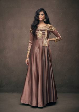 You Will Definitely Earn Lots Of Compliments Wearing This Designer Readymade Gown In Brown Color Fabricated On Satin Silk. Its Rich Fabric And Color Will Give You Look Like Never Before.