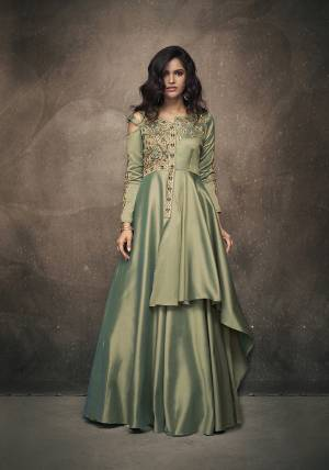 Flaunt Your Rich And Elegant Taste In This New And Unique Shade Wearing This Readymade Gown In Mint Green Color Fabricated On Satin Silk. This Pretty Gown Has Pretty Unique Pattern With Attractive Embroidery. Buy Now.