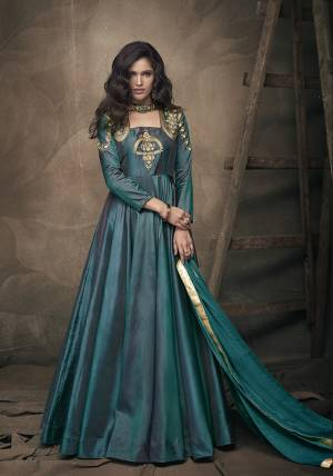 New Shade IS Here To Add Into Your Wardrobe With This Readymade Designer Gown In Teal Green Color Paired With Teal Green Colored Dupatta. Its Top IS Fabricated On Tafeta Art Silk Paired With Chiffon Fabricated Dupatta. It Is Beautified With Embroidery Over The Yoke And Sleeves.