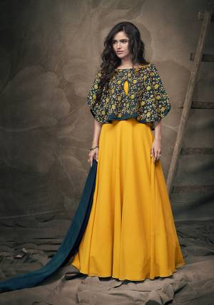 Get Ready For The Next Party At Your Place With This Designer Readymade Gown In Musturd Yellow Color With A Very Pretty And Heavy Embroidered Pine Green Colored Cape And Pine Colored Dupatta. This Pretty Gown IS Georgette Based Paired With Chiffon Fabricated Dupatta. Also It IS Light In Weight And Easy To Carry All Day Long.