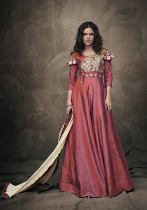 Celebrate This Festive Season Wearing This Attractive Looking Readymade Gown In Dark Pink Color Paired With Cream Colored Dupatta. Its Heavy Embroidered Gown IS Fabricated On Tafeta Art Silk Paired With Chiffon Fabricated Dupatta.