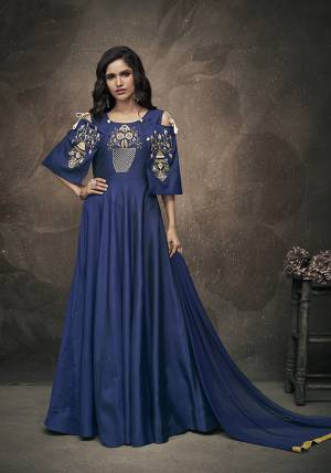 Enhance Your Personality Wearing This Heavy Designer Readymade Gown In Navy Blue Color Which Comes A Very Pretty Navy Blue Colored Dupatta. The Gown IS Fabricated On Tafeta Art Silk Beautified With Embroidery Over Yoke And Sleeves. Buy This Designer Piece Now.