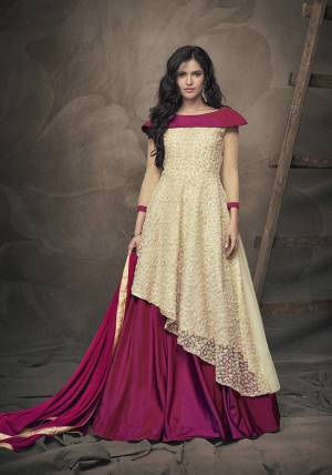 Here Is Beautiful Designer Piece In Cream Colored Top Paired With Contrasting Magenta Pink Colored Lehenga And Dupatta. Its Readymade Top Is Fabricated On Fancy Net Paired With Readymade Tafeta Art Silk Lehenga And Chiffon Dupatta. Choose Your Size As Per Your Desired Fit And Comfort.