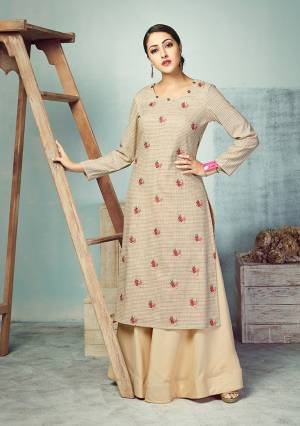 Flaunt Your Rich And Elegant Taste Wearing This Designer Readymade Pair Of Kurti And Skirt In Beige And Cream Color Respectively. This Checks Printed Kurti Is Fabricated On Handloom Cotton Paired With Plain Rayon Fabricated Skirt. Kurti Is Beautified With Small Butti In Thread Work.