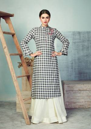 Another Very Beautiful Checks Printed Readymade Kurti Is Here In Black And White Color Paired With White Colored Bottom. Its Top Is Fabricated On Handloom Cotton Paired With Rayon Fabricated skirt. Buy Now.