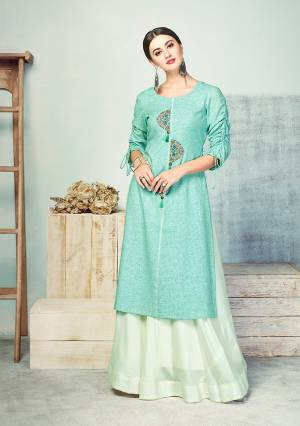 Look Beautiful In This Designer Readymade Pair Of Kurti And Skirt In Shades Of Blue. This Cotton Based Kurti Is In Aqua Blue Color Paired With Rayon Fabricated Baby Blue Colored Skirt. This Kurti Is Beautified With Thread Work And Fancy Sleeve Pattern.