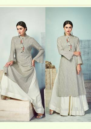 Celebrate This Festive Season With Beauty And Comfort Wearing This Designer Readymade Pair Of Kurti And Skirt In Grey And Off-White Color. This Kurti Is Fabricated On Handloom Cotton Paired With Rayon Fabricated Skirt. Its Elegant Lining Print And Thread Work Gives A Rich Look.