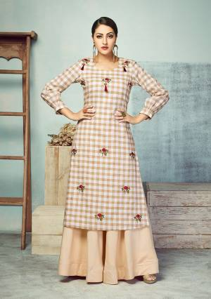 Another Very Beautiful Checks Printed Readymade Kurti Is Here In Beige And White Color Paired With Beige Colored Bottom. Its Top Is Fabricated On Handloom Cotton Paired With Rayon Fabricated skirt. Buy Now.