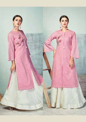 Add This Pretty Simple Readymade Pair Of Kurti And Skirt In Pink And White Color Respectively. It Kurti Is Fabricated On Handloom Cotton Paired With Rayon Fabricated Skirt. Both Its Fabrics Are Light Weight And Ensures Superb Comfort All Day Long.