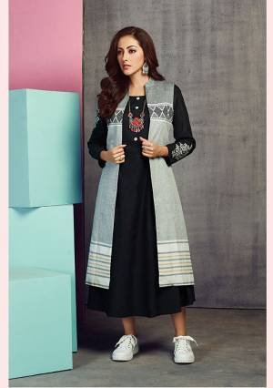 Add This Designer Jacket Patterned Readymade Kurti To Your Wardrobe In Black And Grey Color. It Is Fabricated On Handloom Cotton Beautified With Prints And Thread Work.