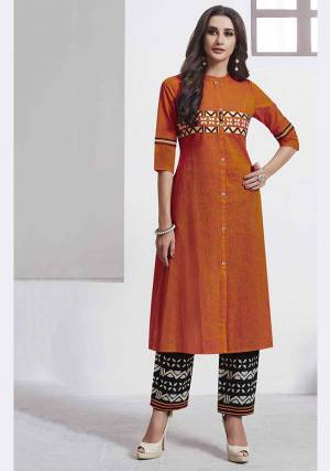 Celebrate This Festive Season With Beauty And Comfort Wearing This Readymade Pair Of Kurti And Pant In Orange And Black Color. This Pretty Pair Is Fabricated On Cotton Which Is Soft Towards Skin And Easy To Carry All Day Long.