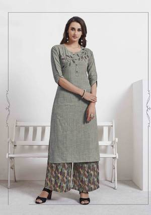 Rich And Elegant Looking Readymade Kurti Is Here In Grey Color Paired With Multi Colored Bottom. This Kurti IS Fabricated On Cotton Beautified With Thread Work Paired With Rayon Fabricated Printed Bottom.