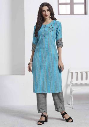 Grab This Very Pretty Pair Of Readymade Kurti And Pant. This Pretty Kurti Is In Blue Color Paired With Grey Colored Bottom. Its Top Is Cotton Based Paired With Khadi Cotton Fabricated Bottom, Beautified With Thread Work.