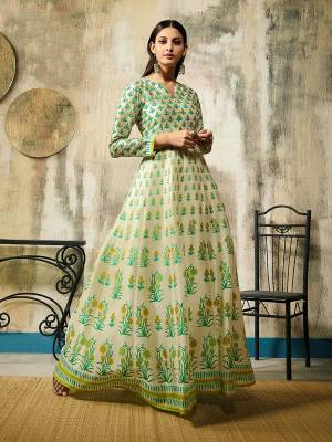 Simple and Elegant Looking Designer Readymade Gown Is Here In Off-White Color Fabricated On Chanderi. It Is Beautified With Digital Print All Over It. Also It Is Light Weight And Easy To Carry All Day Long.